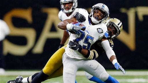 Lions running back Theo Riddick is tackled by Saints cornerback Delvin Breaux in the second half in New Orleans, Sunday, Dec. 4, 2016.