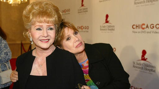 """FILE - In this Tuesday, Aug. 19, 2003 file photo, Debbie Reynolds and Carrie Fisher arrive at the """"Runway for Life"""" Celebrity Fashion Show Benefitting St. Jude's Children's Research Hospital and celebrating the DVD relese of Chicago in Beverly Hills, Calif. On Tuesday, Dec. 27, 2016, a publicist said Fisher has died at the age of 60."""