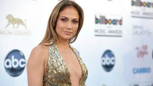 FILE - In this May 19, 2013, file photo, Jennifer Lopez arrives at the Billboard Music Awards at the MGM Grand Garden Arena in Las Vegas. Photos and videos posted online Dec. 30, 2016 of Lopez dancing with and kissing Drake has prompted internet speculation of a duet or romance between the two.
