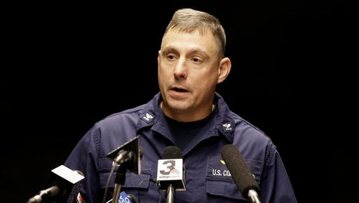 Capt. Michael Mullen of the U.S. Coast Guard answers questions during a news conference at Burke Lakefront Airport, Friday, Dec. 30, 2016, in Cleveland. The U.S. Coast Guard says there's been no sign of debris or those aboard a plane that took off from the airport on the shores of Lake Erie and went missing overnight.