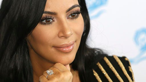 FILE - In this June 24, 2015 file photo, American TV personality Kim Kardashian attends the Cannes Lions 2015, International Advertising Festival in Cannes, southern France. Paris police Monday Jan.9, 2017 say 16 people have been arrested over Kim Kardashian jewelry heist.
