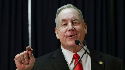 Nebraska state Sen. Bill Kintner of Papillion announces at a news conference in Lincoln, Neb., Wednesday, Jan. 25, 2017, that he is resigning the seat he has held since 2012, following an uproar over a tweet he sent that implied Women's March protesters were too unattractive to be victims of sexual assault. He made the announcement less than an hour before Nebraska lawmakers were scheduled to debate whether to expel him.