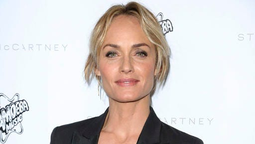 FILE - This Jan. 12, 2016 file photo shows Sierra Club Ambassador, model, actress and Oklahoma native Amber Valletta at the Stella McCartney Autumn 2016 Presentation in Los Angeles. Valletta authored a passionate op-ed piece released Friday, Feb. 3, 2017, on Glamour.com, opposing Oklahoma Attorney General Scott Pruitt's nomination to lead the Environmental Protection Agency.