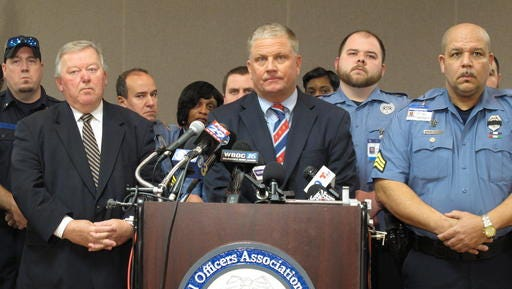 Geoffrey Klopp, center, president of the Correctional Officers Association of Delaware, speaks about a prison uprising Thursday, Feb. 2, 2017, in Dover, Del. Klopp says that he believes the uprising was due to low staffing issues at the 2,500-prisoner James T. Vaughn Correctional Center that have existed for years.