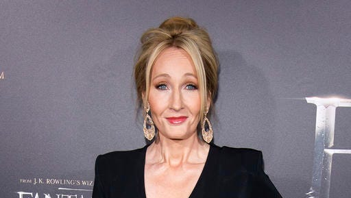 "FILE - In this Nov. 10, 2016 file photo, J. K. Rowling attends the world premiere of ""Fantastic Beasts and Where To Find Them"" in New York. British TV personality Piers Morgan and Rowling are in a Twitter war over American politics. He called her work ""drivel"" and she called him ""amoral"" after Morgan defended the U.S. government's travel ban during an appearance on HBO's ""Real Time with Bill Maher"" Friday, Feb. 10, 2017."