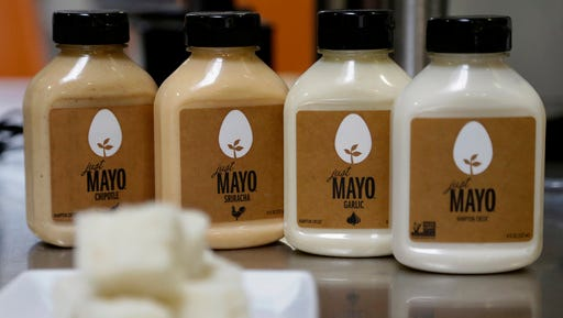 FILE - This Feb. 4, 2015, file photo, shows Hampton Creek Foods bottles of Just Mayo flavors at their office in San Francisco. In 2014, the Association for Dressing and Sauces repeatedly complained to the FDA that an eggless spread was calling itself Just Mayo, noting that under the federal rules mayonnaise is defined as having eggs. The maker of Just Mayo worked out an agreement with the FDA to keep its name, with some strategic tweaks to its label to make clear it does not contain eggs.