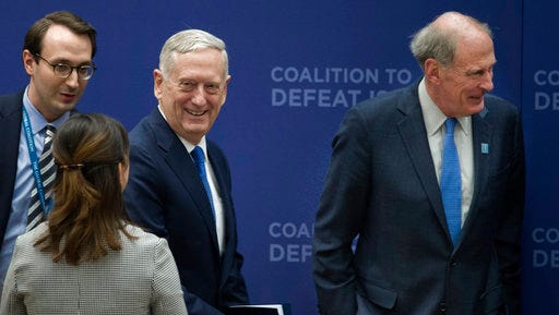 Defense Secretary Jim Mattis, center, and Director of National Intelligence Dan Coats, arrive to attend the Meeting of the Ministers of the Global Coalition on the Defeat of ISIS, Wednesday, March 22, 2017, at the State Department in Washington. Top officials from the 68-nation coalition fighting the Islamic State group are looking to increase pressure on the group as U.S.-backed forces move closer to retaking Mosul.
