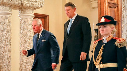 Britain's Prince Charles, left, walks with Romanian President Klaus Ioannis at the Cotroceni Presidential Palace in Bucharest, Romania, Wednesday, March 29, 2017. Britain's Prince Charles has arrived in Bucharest at the start of a nine-day tour to Romania, Italy and Austria that the British government hopes will reassure European Union nations that Britain remains a close ally despite its intention to quit the bloc.