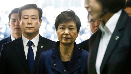 Ousted South Korean President Park Geun-hye, center, arrives at the Seoul Central District Court for hearing on a prosecutors' request for her arrest for corruption, in Seoul, South Korea, Thursday, March 30, 2017.