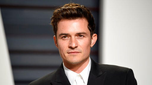 "FILE - This Feb. 26, 2017, file photo, shows Orlando Bloom at the Vanity Fair Oscar Party in Beverly Hills, Calif. Bloom told Elle U.K. for an interview published online April 11, 2017, that he remains friends with ex-girlfriend Katy Perry and says he and Perry are setting an example by showing that breakups ""don't have to be about hate."""