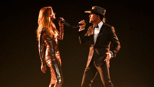 "FILE - In this April 2, 2017 photo, Faith Hill, left, and Tim McGraw perform ""Speak To A Girl"" at the 52nd annual Academy of Country Music Awards in Las Vegas. The country couple with movie star glamour has sold over 63 million albums in the U.S. between their two careers, has earned two Grammys for duets they sang together and has three children. This year, they are releasing their first-ever duet album together and started their third installment of their highly successful Soul2Soul World tour on April 7."