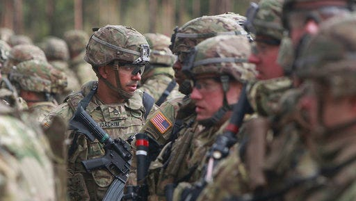 U.S. troops, part of a NATO mission to enhance Poland's defence, are getting ready for an official welcoming ceremony in Orzysz, northeastern Poland, Thursday, April 13, 2017. Poland's Defense Minister Antoni Macierewicz and NATO Supreme Allied Commander Europe, Gen. Curtis M. Scaparrotti are to attend the ceremony for the new force that also includes British, Romanian and other troops.