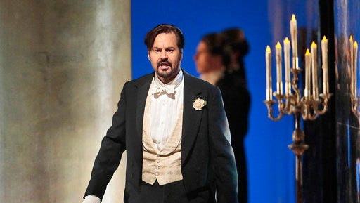 """This April 12, 2017 photo released by the Metropolitan Opera shows Peter Mattei portraying the title character in """"Eugene Onegin,"""" in New York.  The Met's production, created by Deborah Warner, will be broadcast live in HD to movie theaters worldwide on Saturday."""