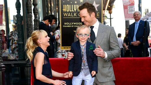 Actor Chris Pratt, right, is joined by his wife, actress, Anna Faris and their son Jack during a ceremony to award Pratt a star on the Hollywood Walk of Fame on Friday, April 21, 2017, in Los Angeles.