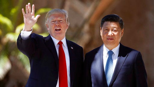 "FILE - In this Friday, April 7, 2017, file photo, U.S. President Donald Trump, left, and Chinese President Xi Jinping pause for photographs at Mar-a-Lago in Palm Beach, Fla. North Korea often marks significant dates by displaying military capability, and South Korean officials say there's a chance the country will conduct its sixth nuclear test or its maiden test launch of an ICBM around the founding anniversary of its military on Tuesday, April 25. Trump spoke by phone with both the Japanese and Chinese leaders Monday, April 24. China's official broadcaster CCTV quoted Xi telling Trump that China strongly opposed North Korea's nuclear weapons program and hoped ""all parties will exercise restraint and avoid aggravating the situation."""