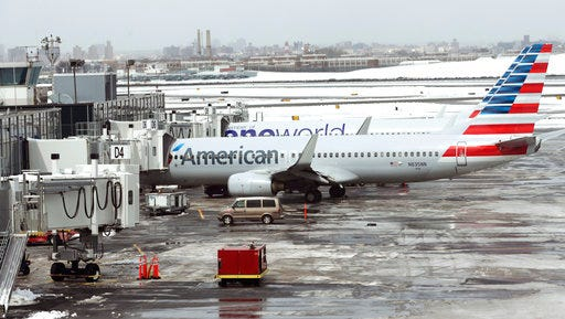 FILE - In this Wednesday, March 15, 2017, file photo, American Airlines airplanes sit on the tarmac at LaGuardia Airport in New York. American Airlines Group Inc. on Thursday, April 27, reported first-quarter earnings of $234 million.