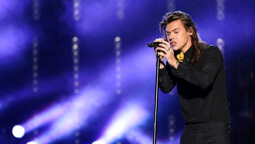 FILE - In this Nov. 22, 2015, file photo, Harry Styles of One Direction performs at the American Music Awards at the Microsoft Theater in Los Angeles. Styles announced a solo world tour on April 28, 2017, ahead of the May 12 release of his self-titled solo debut.