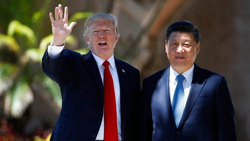 DAY 78 - In this April 7, 2017, file photo, President Donald Trump and Chinese President Xi Jinping pause for photographs at Mar-a-Lago, in Palm Beach, Fla.