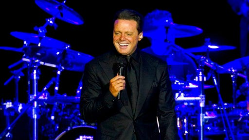 FILE - In this March 11, 2012 file photo, Mexican singer Luis Miguel performs during a concert in Rio de Janeiro, Brazil. Authorities say  Luis Miguel, whose full name is Luis Miguel Gallego Basteri, is in custody after he surrendered to U.S. marshals Tuesday, May 2, 2017, in a case involving a dispute with his former manager.