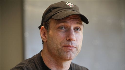 Chris Spielman sued his alma mater over a marketing program he says used athletes' photos without permission.