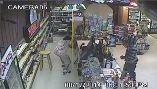 Authorities are seeking two suspects who robbed a Florence liquor store at gunpoint.