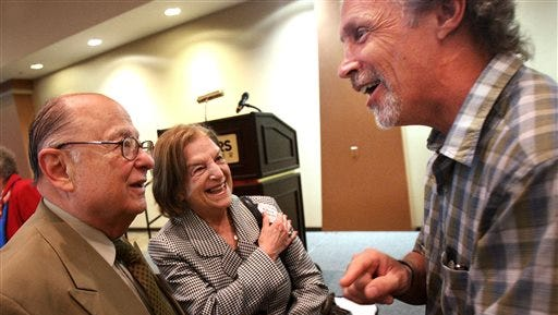 Israeli sculptor-artist Rick Wienecke, right, visits with Romania Holocaust survivors Leonid and wife Friderica Saharovici before a benefit breakfast Monday in Hernando, Miss. The Unknown Child Foundation is raising funds to complete a remembrance park in Hernando.
