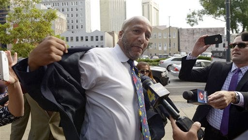 Former New Orleans Mayor Ray Nagin is surrounded by the the media as he arrives for his sentencing hearing Wednesday, July 9, 2014, in New Orleans. Nagin was sentenced to 10 years in prison on Wednesday for his conviction on bribery, money laundering and other corruption charges. Prosecutors said the actions for which he was convicted spanned his two terms as mayor, including the chaotic years after Hurricane Katrina hit in 2005. (AP Photo/The Advocate, John McCusker)   MAGS OUT; INTERNET OUT; NO SALES; TV OUT; NO FORNS; LOUISIANA BUSINESS INC. OUT (INCLUDING GREATER BATON ROUGE BUSINESS REPORT, 225, 10/12, INREGISTER, LBI CUSTOM); MANDATORY CREDIT
