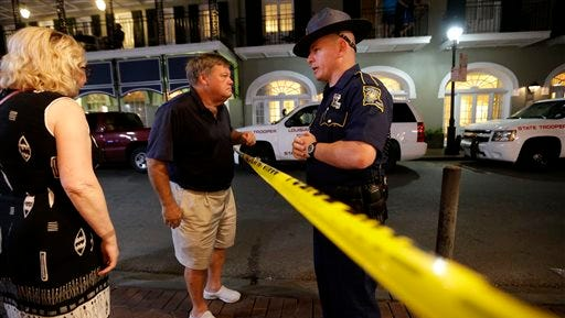A Louisiana state troopers advises passers-bye around the scene of a fatal stabbing on Toulouse Street near Bourbon Street in the French Quarter of New Orleans, Wednesday. Homicide detectives are investigating the fatal stabbing of a 47-year old man who is believed to be homeless. Witnesses told police that they observed the victim involved in a physical altercation.