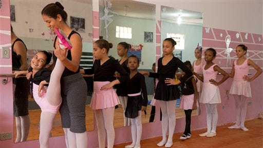 Bballet instructor Joana Machado instructs young girls at her House of Dreams dance studio in Crackland, one of the roughest neighborhoods of downtown Sao Paulo, Brazil. ?We see all kinds of stories here. From girls who haven?t showered in days, who don?t know how to brush their teeth, who are locked inside their homes all day,? said Machado. ?I feel always responsible for their lives, always worried about what may happen.?