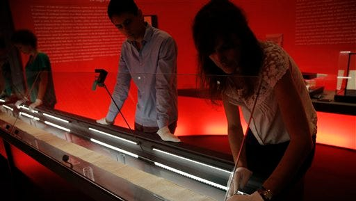 """The original scroll on which the Marquis de Sade wrote the draft of his novel 'The 120 Days of Sodom"""" is displayed at the Letters and Manuscripts Museum in Paris, Friday. The 12-metre (39 foot) long scroll was found in its hiding place when the Bastille prison was stormed during the 1789 French revolution and over the years has repeatedly changed hands and had its ownership. Returning to France, the parchment piece, originally recovered from a cell wall at Paris's Bastille prison, goes on display to mark the bicentenary of Sade's death."""