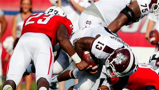 Mississippi State's Josh Robinson (13) goes in for the score past South Alabama safety Roman Buchanan (23) in the first half of an NCAA college football game Saturday, Sept. 13, 2014, in Mobile, Ala. (AP Photo/AL.com, Mike Kittrell) MAGAZINES OUT