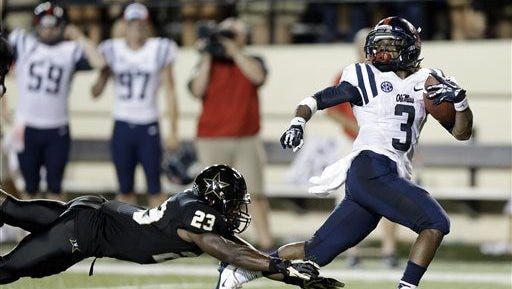Ole Miss running back Jeff Scott's 75-yard touchdown run to beat Vanderbilt is one of the defining moments of the 2013 season.