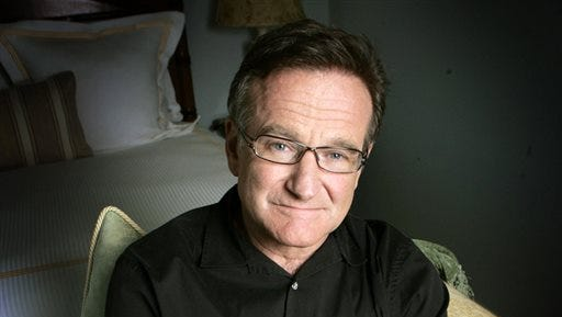 This 2007 file photo shows actor and comedian Robin Williams posing for a photo in Santa Monica, Calif. Williams, whose free-form comedy and adept impressions dazzled audiences for decades, died Monday in an apparent suicide. Williams was 63.
