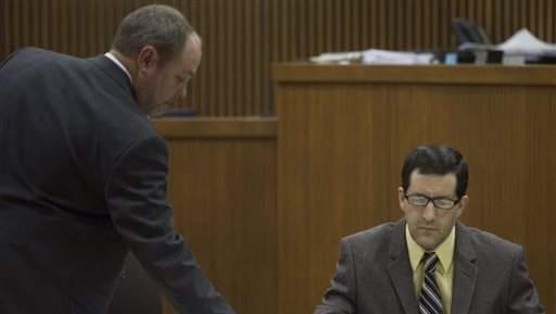 Thomas Franklin May III, right, and his lawyer, Todd Crutchfielf, prepare for jury selection during his capital murder trial at the Lee County Justice Center, Monday, March 10, 2014, in Opelika, Ala. May was charged with capital murder and attempted murder in the April 6, 2011 shooting at Southern Union State Community College. May has pleaded innocent by reason of mental problems.