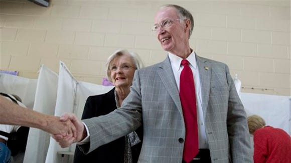 Republican Gov. Robert Bentley shakes the hand of a