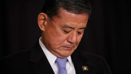 Secretary of Veterans Affairs Eric Shinseki waits to speak at a meeting of the National Coalition for Homeless Veterans in Washington, Friday, May 30, 2014. Shinseki faces calls to resign from both Republicans and Democrats in Congress because of an escalating scandal about problems in the VA's nationwide health care system. (AP Photo/Charles Dharapak)