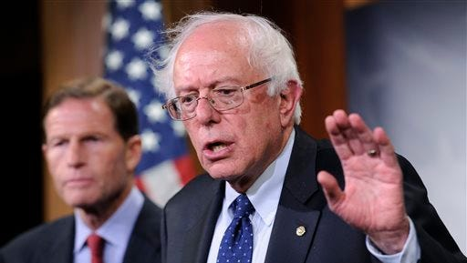 FILE - In this July 24, 2014, file photo, Sen. Bernie Sanders, I-Vt., right, with Sen. Richard Blumenthal, D-Conn., speaks during a news conference on Capitol Hill in Washington. The chairmen of the House and Senate Veterans Affairs committees have reached a tentative agreement on a plan to fix a veterans' health program scandalized by long patient wait times and falsified records covering up delays. Miller and Sen. Bernie Sanders, I-Vt., scheduled a news conference Monday, July 28, to talk about a compromise plan to improve veterans' care. (AP Photo/File)