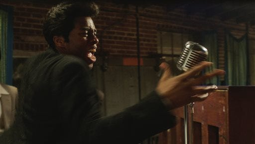 """This image released by Universal Pictures shows Chadwick Boseman in a scene from """"Get On Up."""""""
