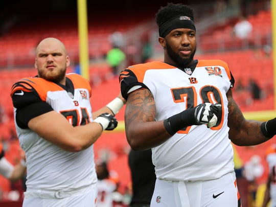 Cincinnati Bengals offensive tackle Jake Fisher (74), left, and Cincinnati Bengals offensive tackle Cedric Ogbuehi (70) stretch before the Week 3 NFL preseason game between the Cincinnati Bengals and Washington, Sunday, Aug. 27, 2017, at FedEx Field in Landover, Maryland.