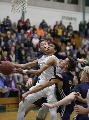 Oshkosh North's Tyrese Haliburton drives to the basket against Appleton North on Friday in Appleton.
