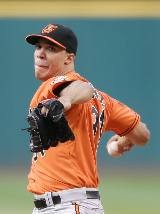 Baltimore Orioles starting pitcher Ubaldo Jimenez delivers in the first inning of a baseball game against the Cleveland Indians, Saturday, Aug. 16, 2014, in Cleveland. (AP Photo/Tony Dejak)