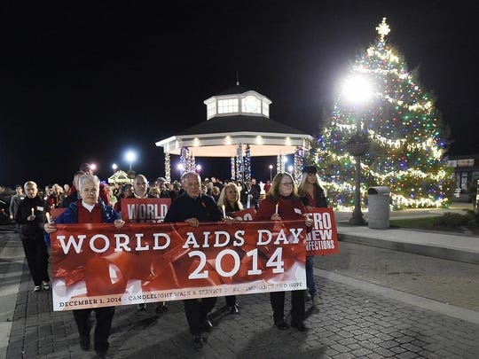 Several hundred gathered for World AIDS Day that was observed in Rehoboth Beach with a candle lighting and walk from the Bandstand to All Saints Church for a Service of Remembrance and Hope in an event sponsored by CAMP Rehoboth in 2014.