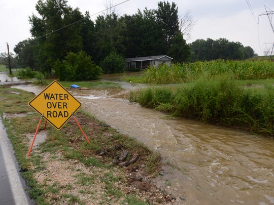 Flooding on Old Medina Road on Friday afternoon was caused by storms.