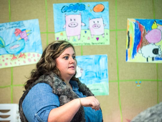 Dawn Ellis works with her special education class on