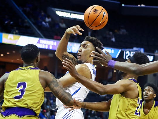 University of Memphis guard David Nickelberry (middle)