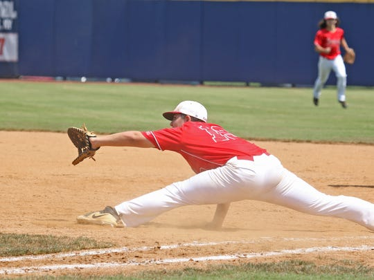 Riverheads' first baseman Matthew Charles gets an out on first against the Honaker Tigers at the Virginia High School League Class 1 state baseball championship at Radford University in Radford on Saturday, June 9, 2018.
