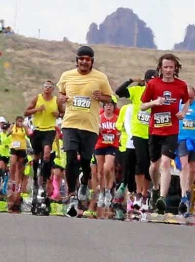 Runners in the half marathon make their way up U.S. Highway 491 during the 33rd Shiprock Marathon on Saturday.