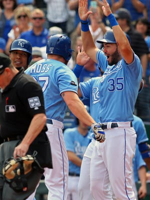 Brandon Moss is congratulated by first baseman Eric Hosmer after hitting a grand slam.