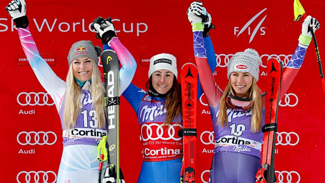 Lindsey Vonn of USA takes second place, Sofia Goggia of Italy win and third-place Mikaela Shiffrin on the podium during the Audi FIS Alpine Ski World Cup Women's Downhill on Jan. 19  in Cortina d'Ampezzo, Italy.