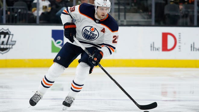 FILE - In this Feb. 26, 2020, file photo, Edmonton Oilers center Leon Draisaitl (29) plays against the Vegas Golden Knights in an NHL hockey game in Las Vegas. The Edmonton Oilers' sudden resurgence placed Connor McDavid back in the NHL MVP conversation, along with teammate Leon Draisaitl. Colorado's Nathan MacKinnon and Boston's David Pastrnak made their case, too, during a pandemic-shortened season. And don't forget New York Rangers' Artemi Panarin, a late entry in the discussion.